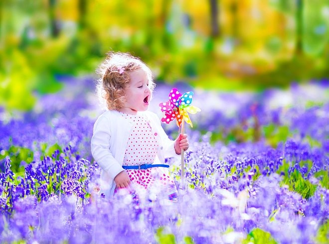 Girl is surrounded by flowers