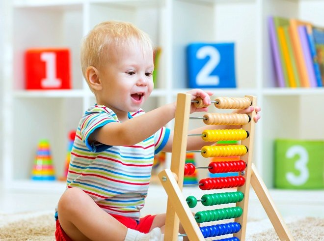 Little boy is playing abacus